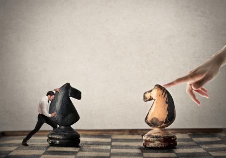 Photo pour Businessman playing chess against an unknown player - image libre de droit