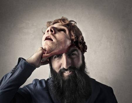 Man revealing his true face