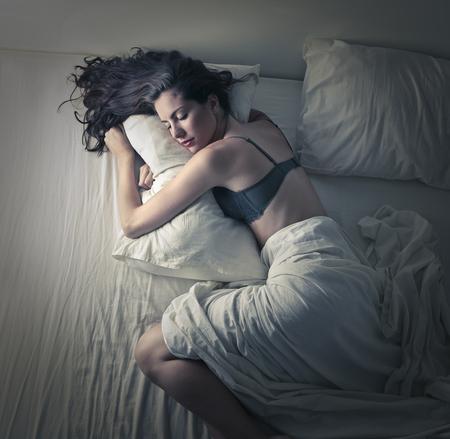 Beautiful woman asleep in her bed