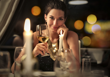 Photo pour Sensual woman drinking a glass of white wine - image libre de droit