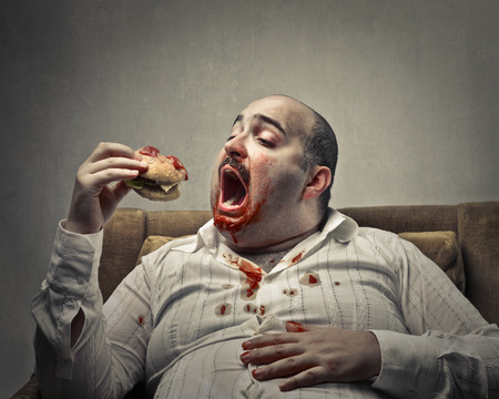 Photo for Fat man eating a sandwich - Royalty Free Image