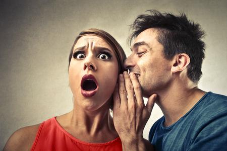Foto für Man whispering in a woman's ear - Lizenzfreies Bild