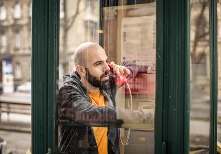 Man using a phone box