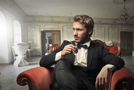 Photo pour Handsome man sitting in an elegant room - image libre de droit