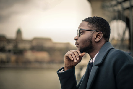 Photo for Businessman thinking in the open air - Royalty Free Image