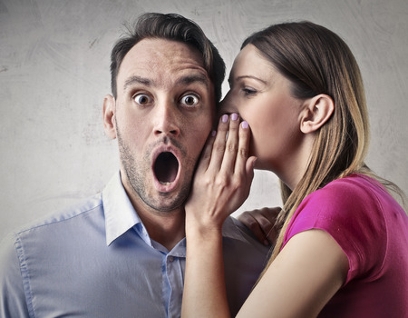 Foto für Woman whispering into a man's ear - Lizenzfreies Bild