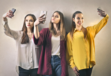 Photo for Girls doing a selfie - Royalty Free Image