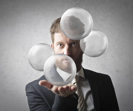 Manager holding transparent spheres