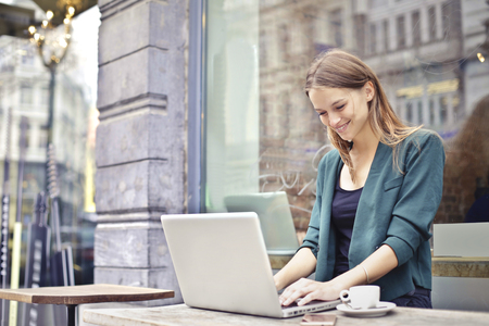 Photo for Woman working on her laptop - Royalty Free Image
