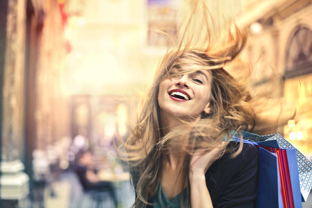 Photo for Happy woman carrying shopping bags - Royalty Free Image