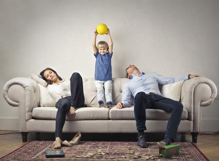 Foto de Their tired parents with happy child - Imagen libre de derechos