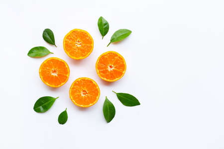 Orange fruits with leaves on white background. Top view, Copy space