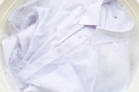 Photo pour Soak a cloth before washing, white shirt - image libre de droit