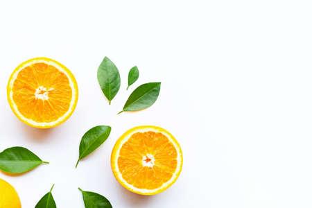 Foto de Fresh orange citrus fruits with leaves on white background.  Copy space - Imagen libre de derechos