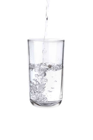 Photo pour Pouring water into a separate glass on a white background. Clean drinking water concept - image libre de droit