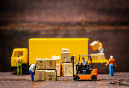 Photo for miniature warehouse workers forklift carrying goods box to semi truck with trailer .logistics warehouse freight transportation concept - Royalty Free Image