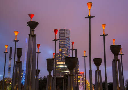 Melbourne, Australia - May 10 2015: Eureka tower the tallest building in Melbourne view from Birrarung Marr with Federation Bells a set of 39 bronze bells located in central Melbourne.