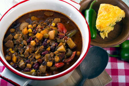 Spicy vegetarian chili with a slice of cheddar cornbread