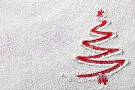 Photo pour Christmas tree on flour background. White flour looks like snow. Top view - image libre de droit