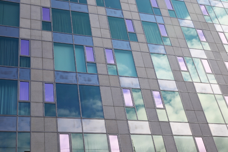 Glass facade of modern building as background