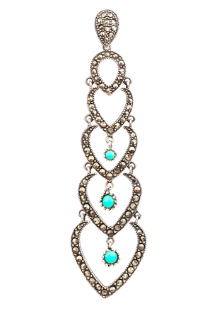 Long silver earring with turquoise isolated on white