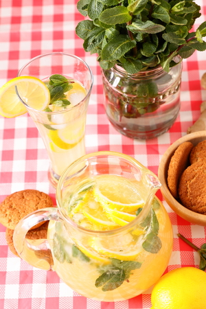 close up of glass of homemade lemonade and oatmeal cookies
