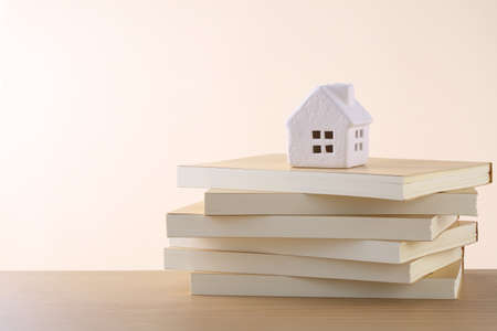 Photo for put a model of a house on top of a book - Royalty Free Image