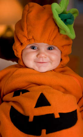 Baby girl in Halloween pumpkin outfit