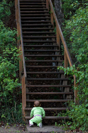 Baby at bottom of long staircase