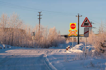 Railway crossing in winter. Road sign railway crossing without barriers.