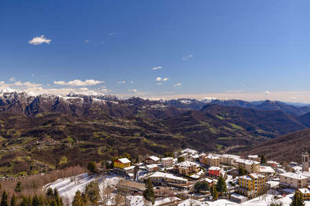 Foto per Snow-covered village in valle imagna, mountain landscape Lombardo, Italy, spring 2018 - Immagine Royalty Free