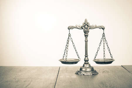 Law scales on table  Symbol of justice  Sepia photo