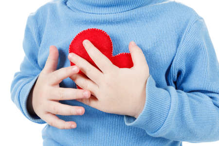 Photo pour Hands holding a heart symbol baby, clutching his chest. Concept of love, health and care - image libre de droit