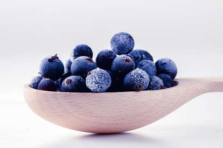 Foto de Frozen berry food and blueberry delicious dessert in spoon, on white. - Imagen libre de derechos