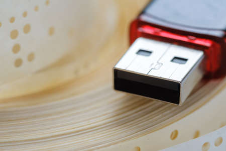 Usb flash drive and obsolete punched tape paper storage,  data.