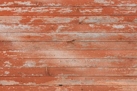 Photo pour Background of old wooden board with peeling cracked red paint - image libre de droit