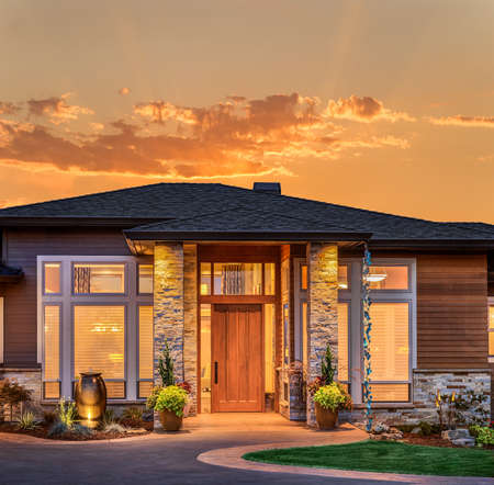 Photo for Front elevation of luxury home in evening - Royalty Free Image