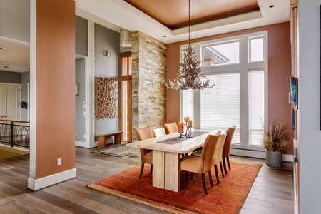 Photo pour Dining Room with Entryway, Table, Elegant Light Fixture - image libre de droit