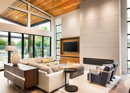 Photo for living room interior with hardwood floors, vaulted ceiling, and fireplace in new luxury home - Royalty Free Image