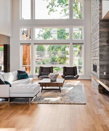 Foto de living room interior with hardwood floors and fireplace in new luxury home - Imagen libre de derechos