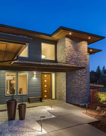 Foto de New Home Exterior at Night, Vertical Orientation - Imagen libre de derechos