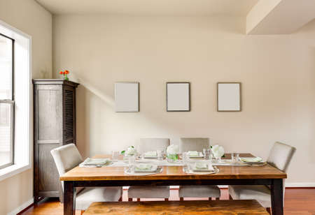 Photo for Furnished Dining Room with Place Settings - Royalty Free Image