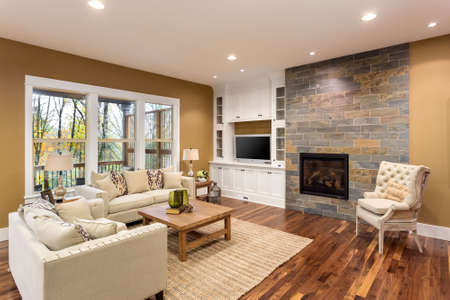 Photo pour Beautiful living room interior with hardwood floors and fireplace in new luxury home - image libre de droit