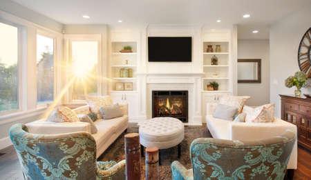 Foto de furnished living room interior in new luxury home, with bright blast of sunlight - Imagen libre de derechos