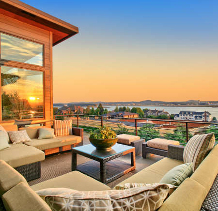 patio of a newly constructed luxury home with beautiful sunset view