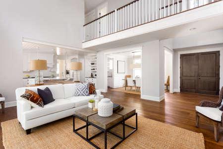 Foto de Living room interior and foyer, entry, and kitchen in new home - Imagen libre de derechos
