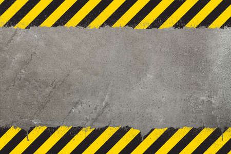 Photo pour Concrete weathered wall background with yellow and black painted grunge hazard sign stripes and copy space - image libre de droit