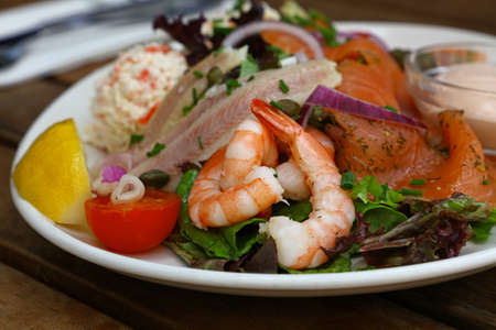 Photo pour Close up large cold and smoked seafood platter on wooden table, high angle view - image libre de droit
