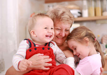 Cute little boy and little girl happy with grandmother