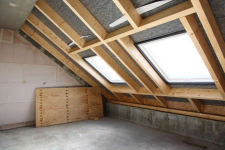 Refurbishment - empty room under construction with two roof-lights